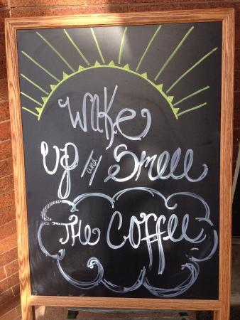 Mama D's Coffee: Sign outside cafe door.