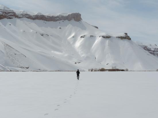 Bamyan, Afghanistan: People on top of freeze lake