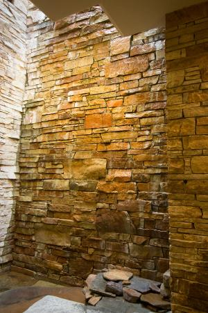 Rosewood Inn of the Anasazi: Second-Third floor rock wall with flowing water.  Nice touch