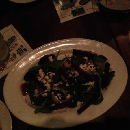 Frankie Bones Restaurant and Lounge: poor quality photo but this spinach walnut beet salad was delicious