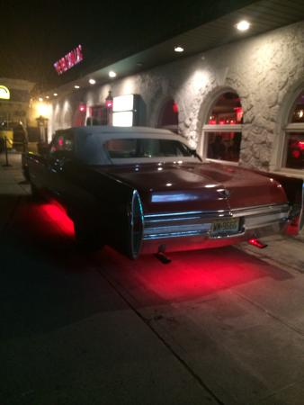 tailpipe picture of the red cadillac tacos tequilas. Cars Review. Best American Auto & Cars Review