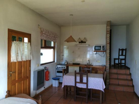 """Cabanas Las Cuatro Estaciones: living / comedor / cocina y pasillo acceso al baño y dormitorio cabaña """"confort"""""""