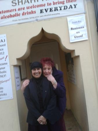 Shahi Raj: photo one of us outside the door to her restaurant