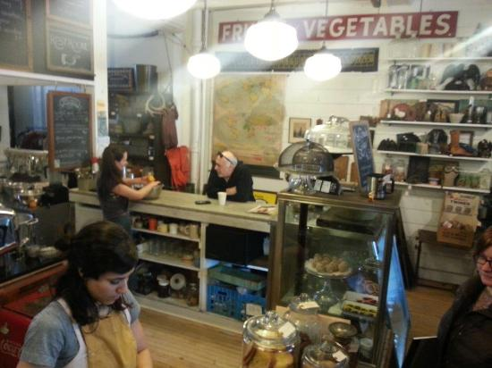 Outdated, An Antique Cafe : The register area, the owner Tarah is in the background. Antiques all over the walls. Fun!