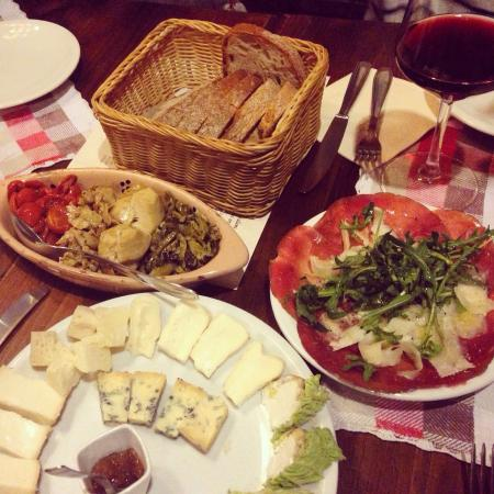 Il Goccetto : Getting goosebumps as I recall the tasty appetizers... Pictured above is the mixed cheese dish,
