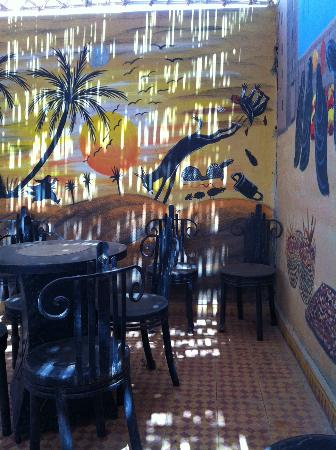 Cafe-Restaurant des Dunes: One of the many painted murals in the rooftop eating area.