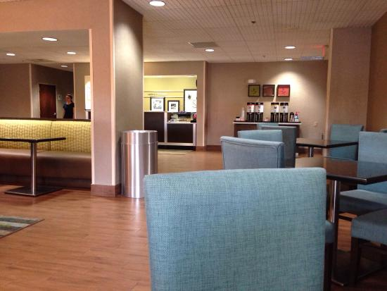 Hampton Inn Florence-Midtown: Lobby/breakfast area. There is also a convenient coffee stand next to the lobby desk, seen on th