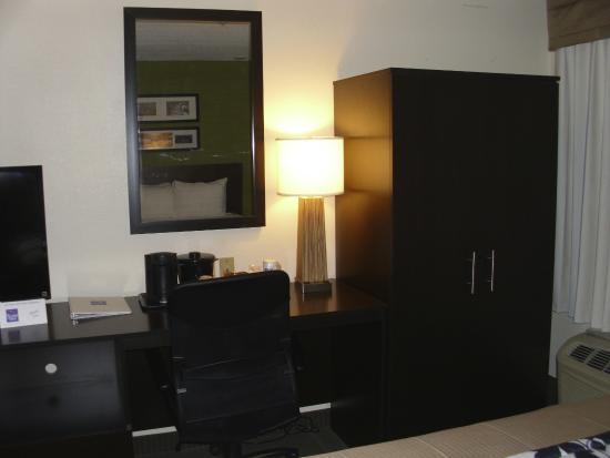 Sleep Inn : Armoire with ironing board, iron. Desk/chair
