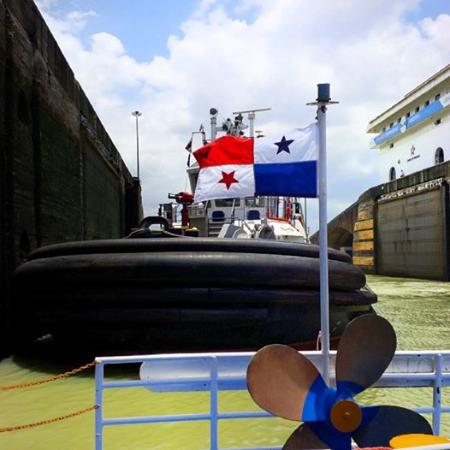 Panama Canal Partial Transit Tour: Wait for the tug boat to position us in the lock