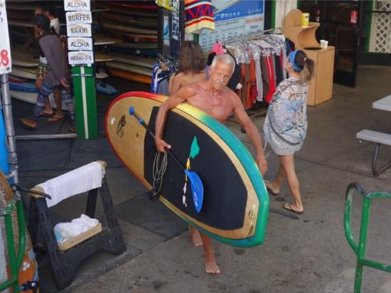 Moku Surf shop: Happy moment.. leaving the fantastic shop with te board