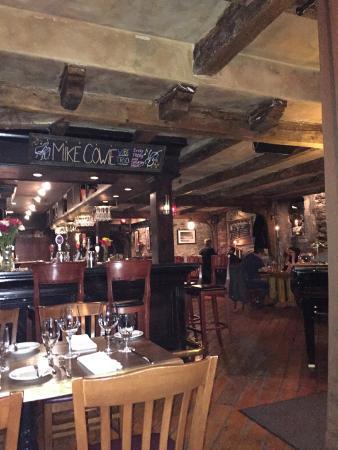 The Press Gang Restaurant & Oyster Bar : Bar area tables.