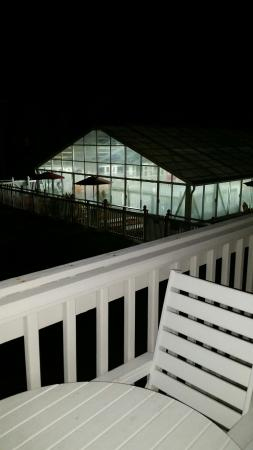 Peppertree Atlantic Beach, a Festiva Destination: View of the indoor heated pool at night. Hours are 10am-10pm.