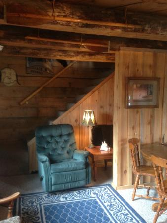 """Le Barn Appetit Inn & Creperie: """"Jack London's Cabin"""" living/dining room with stair case to 2nd floor"""