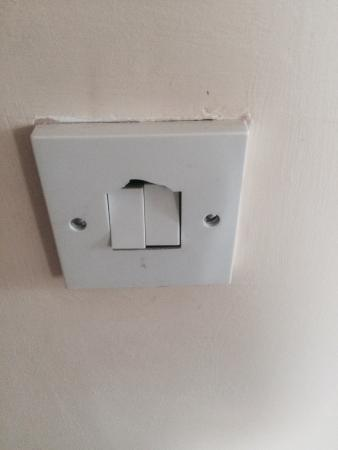 Titanic Apartments: This is the damaged light switch in the lounge. I hope they repair it now I have brought it to t