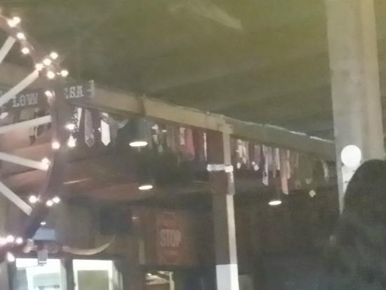 Pinnacle Peak Steakhouse Ties Hanging On Walls And Tarp Ceiling