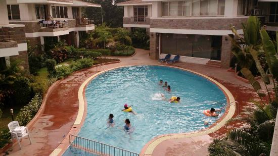 Ext day swimming pool from room picture of wonderland - Hotels in silvassa with swimming pool ...