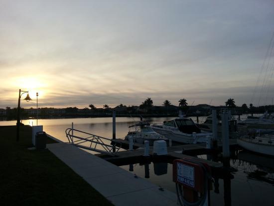 Port of the Islands Everglades - Adventure Resort: Marina sunset behind hotel.