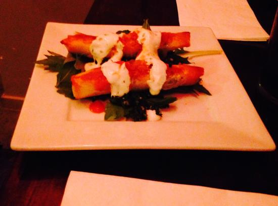 Nomad Cafe: Spina Cigars– Seasoned spinach and feta cheese wrapped and baked in filo pastry - served on tabo