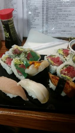 Noble Fish: Michigan Roll with Eel, scallop, and yellowtail
