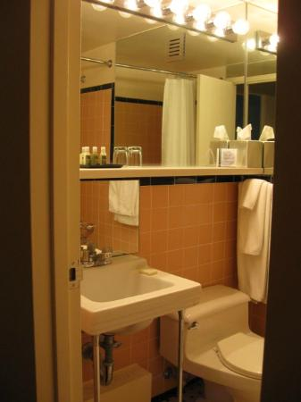 Small Clean Bathroom With Heater Air Conditioning Under Sink