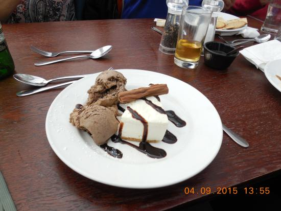 Vanilla Cheesecake with Chocolate Ice Cream with toppings at The Moorings Restaurant.