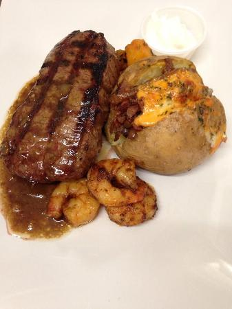 Cove Country Inn Resort & Spa: Striploin with Cajun Shrimp and Loaded Baked Potato