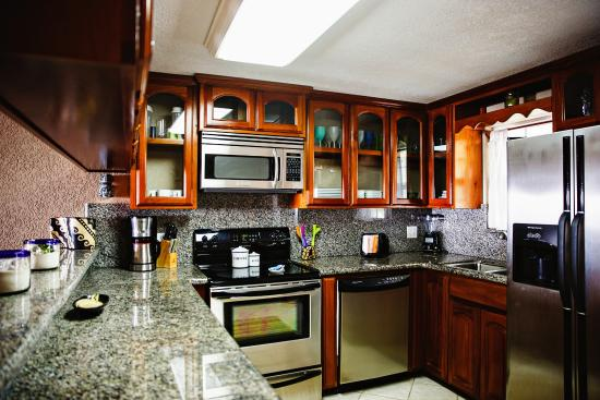 Pelican Reef Villas Resort: Handmade wood cabinets with fully equipped kitchens