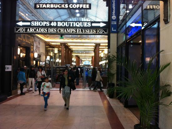 At the starbucks picture of starbucks arcades des champs - Comptoir des cotonniers champs elysees ...