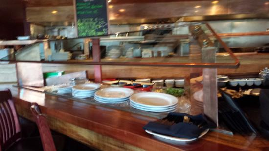 Three Peaks Grill: Oyster Bar in front of Open Kitchen