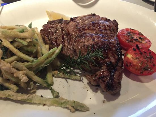 A Tavola: TBone with zucchini chips and grilled tomato