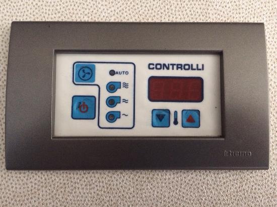 AC Hotel Gava Mar: Room a/c unut control with damaged buttons