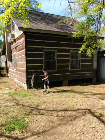 French Camp Bed and Breakfast Inn: back of cabin where boys were playing hide and seek tag
