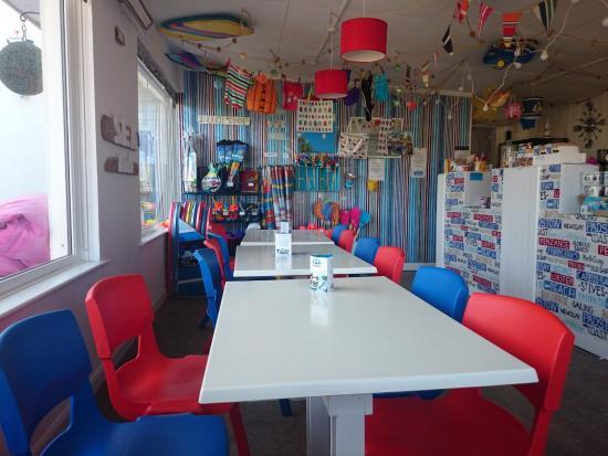Coast Cafe: Cafe Coast Porth inside colourful seatings