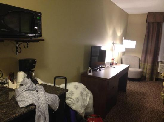 Super 8 Regina: View of tv/desk and sink/fridge/microwave area.