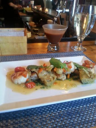 Chez Nous : half order of scallops, braised artichokes, veggies and potato gnocchi