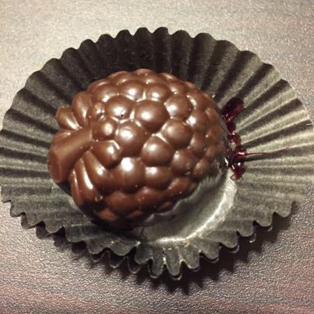 DeBrand Fine Chocolates: Dark chocolate raspberry creme.....almost too pretty to eat.  Almost.....