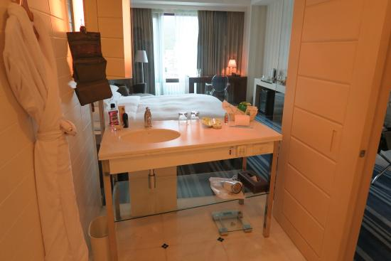 Grand Victoria Hotel: sink and view to bedroom from the bathroom