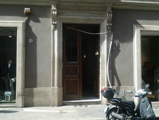 Spagna Ave: Front door with draped conduit