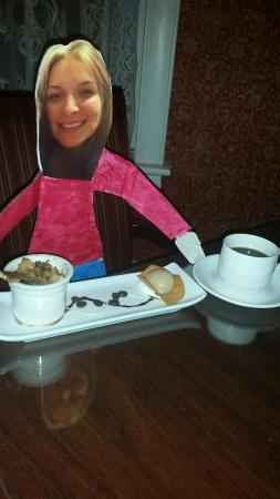 Cliff House Hotel Dining Room: Flat Jaclyn enjoying cinnamon bread pudding and coffee after dinner