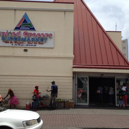 Andall associates supermarket entrance- creole shack upstairs