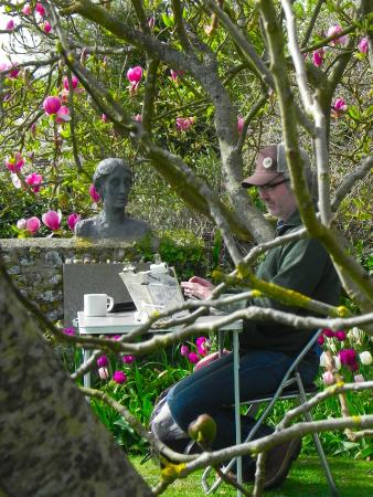 Monk's House - National Trust: A performance artist in the garden writing out 100 great classics is copying Orlando