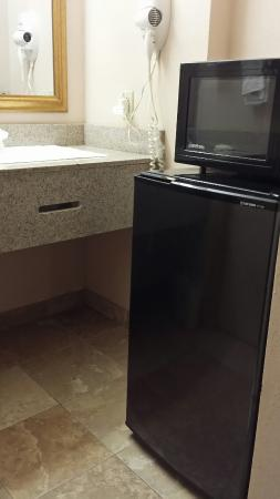 Econo Lodge: I appreciate the refrigerator and microwave, but it needs to be moved where the extra office cha