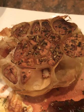 Hotel Platanenhof: Roasted Giant Garlic accompanied by Cowboy Ribeye.  Melts in you mouth!