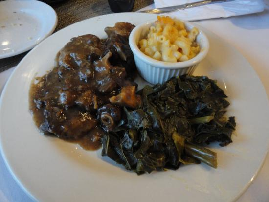 At the Table: Oxtail stew with collard greens & mac and cheese