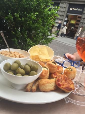 Caffe Milano: Plate of pastries, olives, peanuts and chips on the house