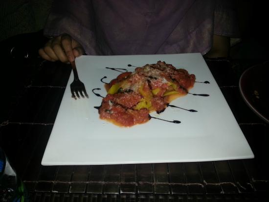Bene: This is the open ravioli, baked in tomato sauce