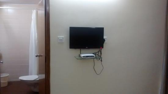Ajantha Hotel : TV and bathroom view (deluxe ac room)