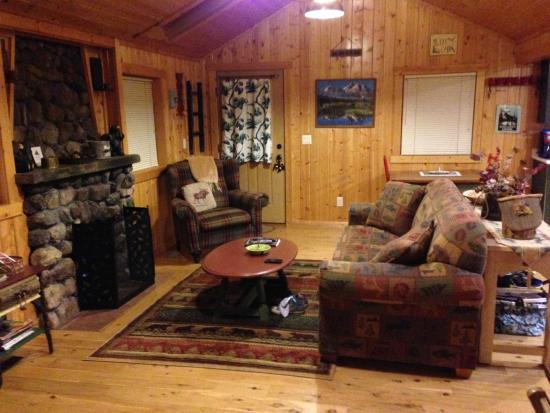 Knotty or Nice Cabin: Living room view from the bedroom door