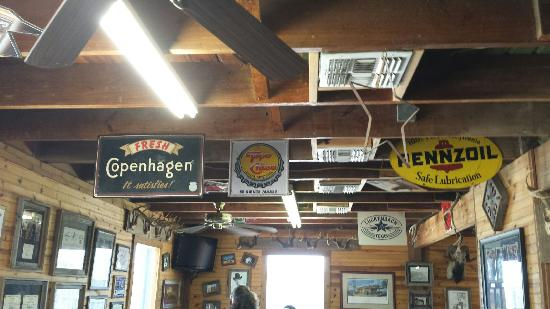 Johnny's Steaks & Bar-Be-Que: Interesting to read: hanging antique signs on Johnny's restaurant ceiling