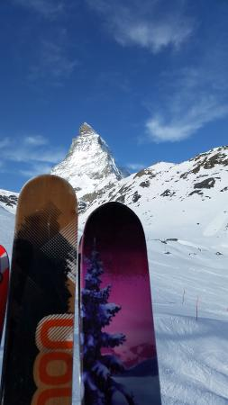 Alpine Exposure : my love and my skis in front of the Matterhorn, amazing view